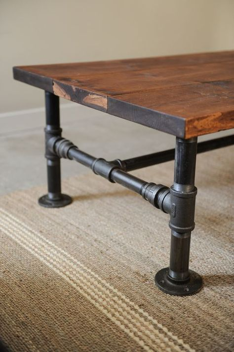 Turn some plumbing supplies and a couple of old planks into a great rustic industrial style coffee table. Clever. Or maybe a craft table?