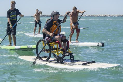 Charles Webb, a paraplegic athlete who started paddleboarding earlier this summer on an adaptive board, finishes the 4-mile open water race ...