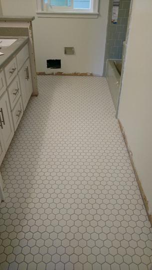 Merola Tile Metro Hex 2 In Matte 11 1 8 In X12 5 8 In Black Porcelain Mosaic 9 64 Sq Ft Case Fxlm2hmb The Home Depot Hexagon Tile Bathroom White Hexagon Tile Bathroom Hexagon Tile Kitchen Floor