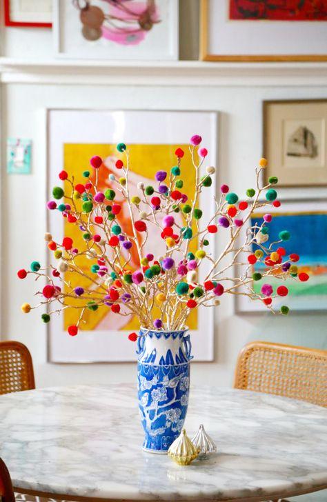 Pom Pom Branches, branches (plain or painted), pom poms, glue gun. Self explanatory. Home Decor christmas Craft Lightning: Christmas Pom Pom Branches - Aunt Peaches