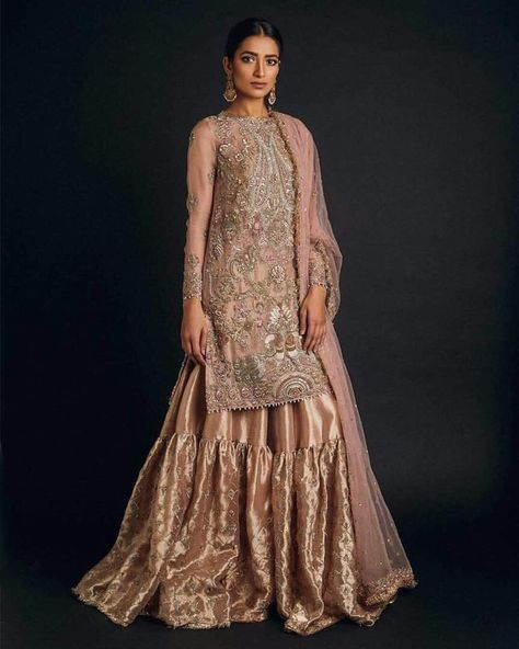 Pink golden gharara set work embellished with dabka zari nagh and threads work 1.%100 Accurate Measurement & Fitting.(Please Ask Us Your exact measurement) 2.All Dresses are Manufactured designs/Cutting/stitching Under The Supervision of Our Qualified designers.3.We Deliver On Time.4.Made with High Quality Fabric &