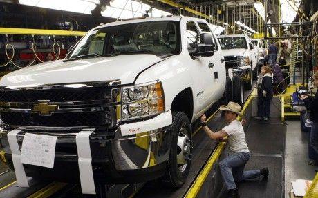 General Motors Employees Work On A Chevrolet Silverado Pickup
