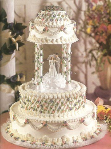hahahaha #4 of wedding things I hate. Your cake should NEVER have plastic pillars. This was only excusable in the 80's and possibly early 90's. Pretty sure some family members had ugly cakes like this back in the day but no one should ever do this in 2013!