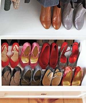 """Organized shoe drawer. """"The drawers were built for shoes,"""" says Margot. """"But laid flat, my shoes didn't fit well. Angling was the solution, so I hired a carpenter. It took a few tries to get the pitch right."""""""