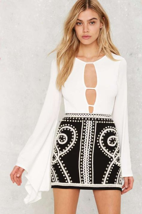 Nasty Gal Third Times a Charm Bell Sleeve Bodysuit Never worn, super cute white bodysuit from Nasty Gal. Bell sleeves, deep v neck, open back, velcro crotch closure. Tags and hygienic liner never removed.
