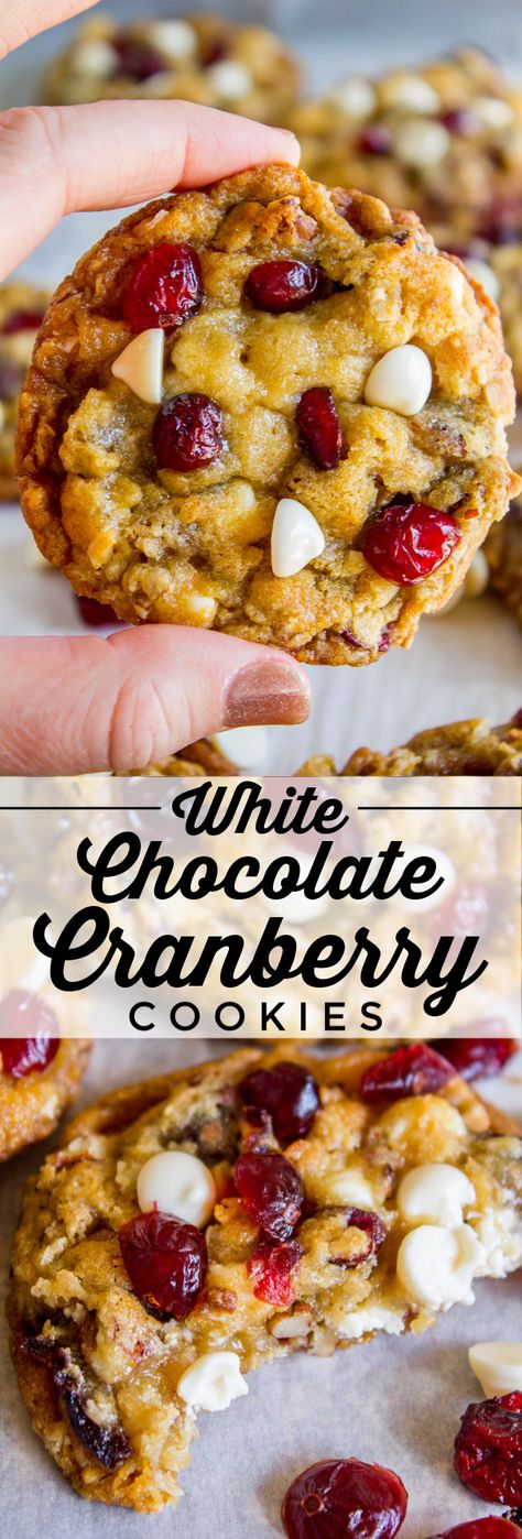 White Chocolate Cranberry Cookies from The Food Charlatan. These White Chocolate Cranberry Cookies have got it all: tons of white chocolate, juicy cranberries, chopped toasted pecans, flaked coconut, old fashioned oats, oh my! They are thick and chewy and slightly crisp on the edges with a moist and tender center. They are based on my Texas Cowboy Cookies, one of the most popular recipes on my blog! #whitechocolate #cranberry #cranberries #cookie #oats #oatmeal #butter #recipe #easy #christmas