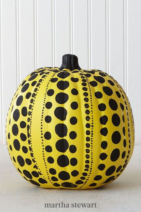 Polka-dots and colors that pop make this pumpkin—a la artist Yayoi Kusama—a showstopper. To paint this pumpkin, use a combination of pouncers and detail brushes dipped in black craft paint to design a series of circles. #marthastewart #pumpkins #diypumpkins #falldecor #halloween