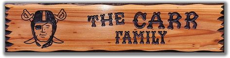 Show the world your love of the game with this unique football decor. This rustic sports sign features the helmet wearing black pirate raider hand carved in the design and is beautifully distressed for an authentic vintage look.