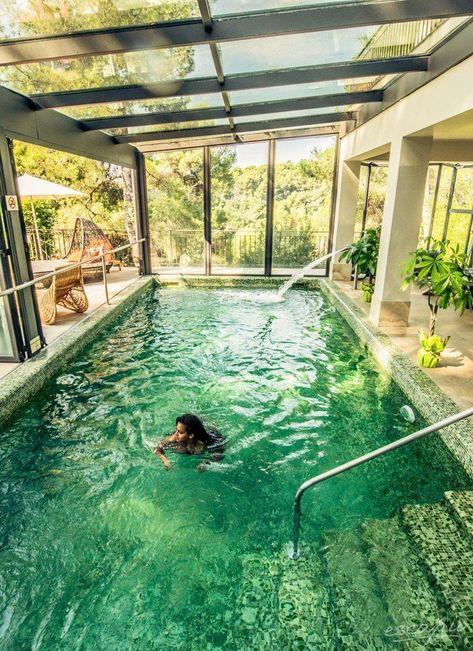 Swimming pool designs featuring new swimming pool ideas like glass wall swimming pools, infinity swimming pools, indoor pools and Mid Century Modern Pools. #swimmingpools