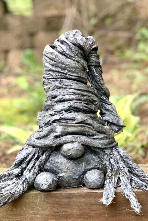 Cute garden ornament decoration for your front lawn or backyard. Learn how to make a concrete gnome garden on a budget.