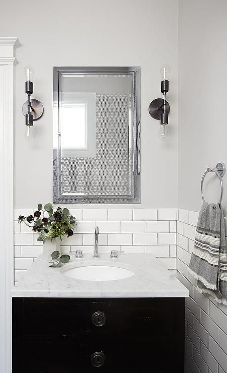 Soft Gray Walls Are Accented With White Subway Tiles Finished With Gray Grout Lined W Tile Backsplash Bathroom Black Vanity Bathroom White Subway Tile Bathroom
