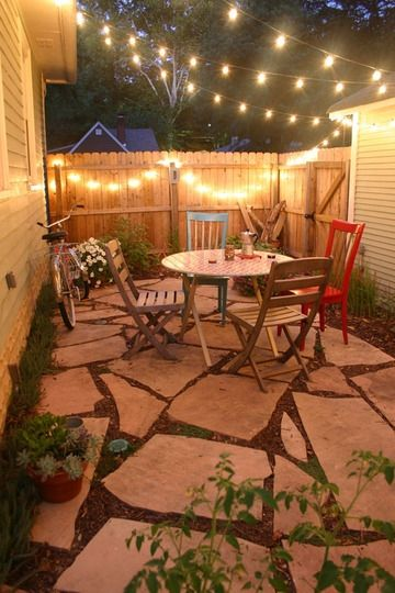 Don't know if the patio has strings of light over it but it would be cool in the summer evenings to have a set up like this. Maybe even add a couple of heat lamps.