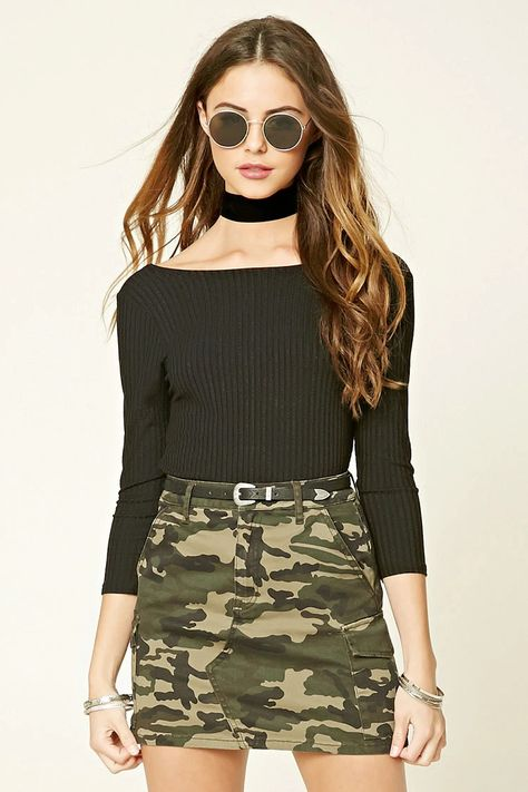 A mini skirt featuring an allover camo print, two front slanted pockets, two fla.