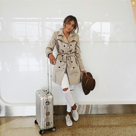 Airport look!cute outfit idea for traveling!love the Burberry coat,the cut off jeans in white with laced flats and a hat!