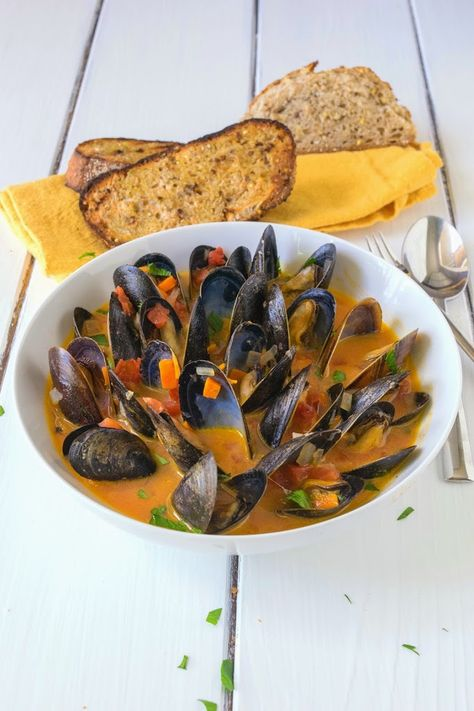 Based on the Belgian classic, moules (mussels) provençale. A rich tomato based broth, with wine, garlic and fresh parsley, mussel soup in under 20 minutes.