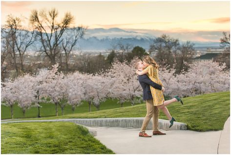 Romantic engagement with couple dressed up in suit and yellow dress in the cherry blossoms at sunset | Spring Blossom Engagement at the Utah State Capitol | Utah Wedding Photographers | Jessie and Dallin  #engagement #engagementphotography #engagementsession #utahengagement #engagementoutfits #elegantengagement #utahweddingphotography #rockymountainengagement #springengagement #blossomengagement #cherryblossoms #romanticengagement