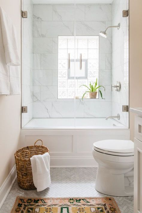 Traditional Bathroom 162129655322078684 - Glass shower door and glass block windows, marble herringbone floors and persian rug make for bright and modern master bath. Lakeview Chicago Master Bath — Sarah Montgomery Design Source by sarahmontgomerydesign Guest Bathrooms, Upstairs Bathrooms, Modern Bathroom, Bathroom Small, Minimal Bathroom, White Bathrooms, Small Master Bath, Contemporary Bathrooms, Bathroom Tile Showers