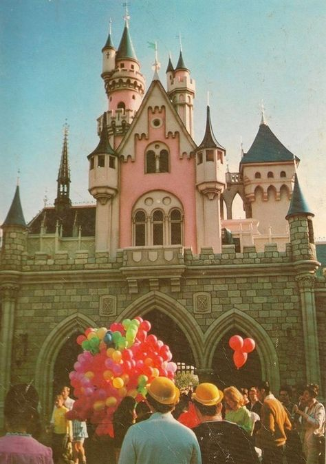 Vintage Disneyland. Classic Fantasyland with Micky Balloons & Sleeping Beauty Castle.