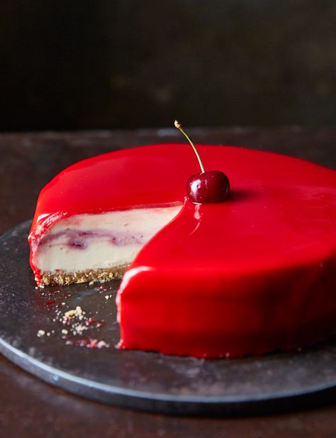 White chocolate and cherry cheesecake with a red mirror glaze - This cheesecake is an absolute stunner! It will definitely wow your guests