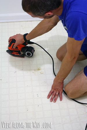How to completely make over vinyl or laminate floors with paint. Must try this!!