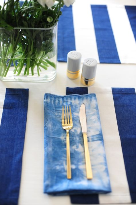 Make entertaining fun and festive with DIY tie-dye napkins to set the table.
