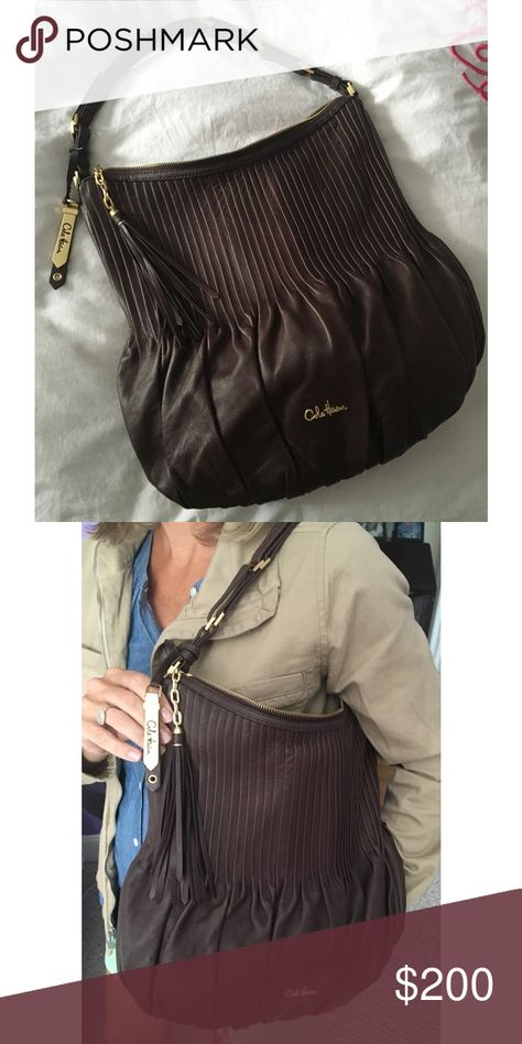 Cole Haan Purse Brown leather, 100% authentic Cole Haan purse. Never used. My dad gave this to my mom as a gift and it just wasn't her style. Perfect condition. Cole Haan Bags