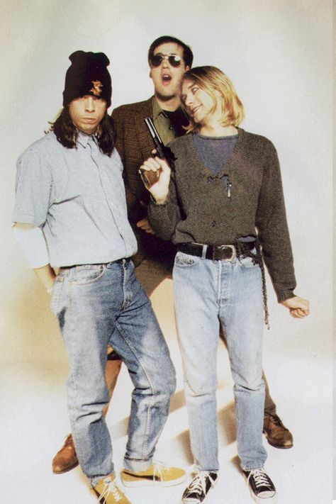 """""""Fun """" photo session with Nirvana and leader, gun lover Kurt Cobain. These images and photo session curiously 'In Utero'  until  after Cobain's death from a gunshot wound to the head in April 1994...Some pics leaked out to tabloids but most hidden from the public..."""