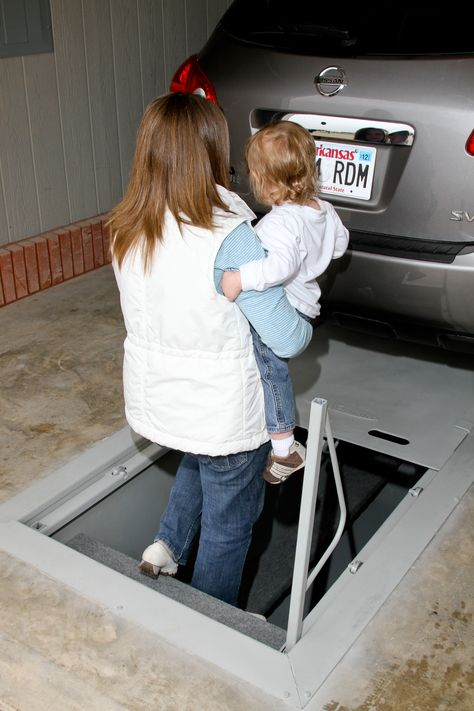 Storm shelter in the garage floor. Park right over the shelter.