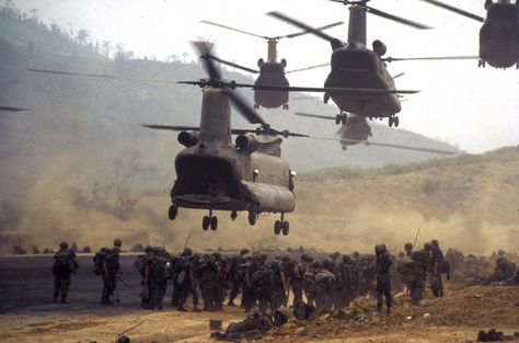 Chinook helicopters taking off after deploying ground troops along area known as