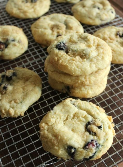 Blueberry Muffin Top Cookies. These Blueberry Muffin Top Cookies are a yummy cross between a muffin and cookie with the perfect crumb coating! #blueberrycookies #cookies #cookierecipes #dessertrecipes #blueberrdesserts