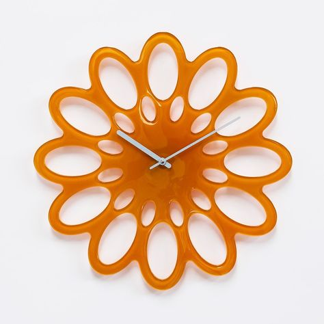 'flor' glass wall clock designed by raffaele darra for progetti
