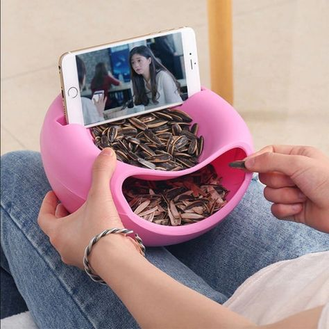 1. A good way to enjoy your snacks and movies at the same time. Perfect for serving pistachio, sunflower seeds, peanuts and other nuts and fruits.2. 2in1 design snack serving bowl set will keep your food and rubbish separate and organized. Nut bowl with cellphone holder slot compatible with 99% of smartphones.3. Good gift to your families or friends,children,makes it easy and convenient to dispose of shells and easily wash.4. Perfectly size at 8.3 IN x 4.5 IN and created with 100% durable and sa