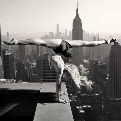 Scenic yoga. Because, why not do a split handstand hundreds of feet above the ground?