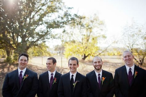 The groomsmen matched the fall color palette with plum ties and deep orange and purple calla lily boutonnieres. M Sibthorpe Photography.
