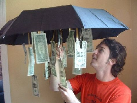 Cute gift idea......Get an inexpensive umbrella from the dollar store and dangled bills from the inside so that when opened up – tada! A little something for a rainy day… And tons of other cute ways to give money as a gift.