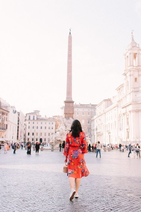 Bill Gates Think Week. The importance of mental creativity. Why you need to disconnect. Photo is taken at Piazza Navona in Rome, Italy. This is a must-see in Rome. Also wearing a floral dress with pockets. The perfect spring dress. How to wear dresses with sneakers.White sneakers outfits.  #mentalcreativity #socialmediadetox #rome #piazzanavona #whitesneakersoutfit