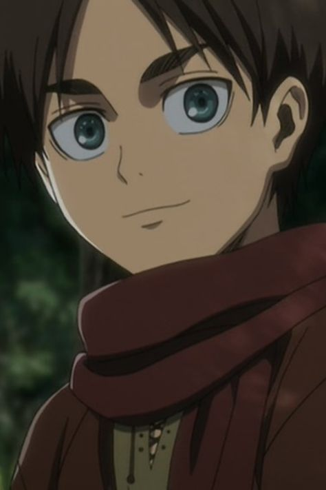 Young Eren Yeager smiling with a light still behind his green eyes. Attack on Titan Season 3 anime.