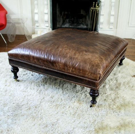 LARGE, SQUARE LEATHER OTTOMAN Double studs at side, round legs, cators on feet.
