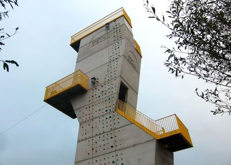 Visitors to this lakeside concrete tower in the Netherlands can scale its walls, jog up to an observation deck on its roof, or sail a zip wire across the water from a balcony.