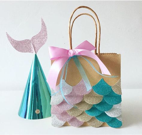 Stunning handmade party hats - the perfect finishing touch to any mermaid themed party. ▫️Handmade with love ▫️Beautifully detailed ▫️Mermaid theme ▫️Mermaid tail design ▫️Assortment of colours - pink, real and purple ▫️Matching party bags ▫️Matching invitations ▫️Matching mermaid wands available ▫️Production time is approximately 7 days - Please contact me if you need a rush order BESPOKE DESIGN SERVICE AVAILABLE. PLEASE CONTACT ME FOR OTHER CHARACTERS/ THEMES. DISCLAIMER: This item is...