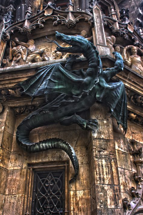"bluepueblo: Dragon, Town Hall, Munich, Germany photo via afine  ""No, I would not want to live in a world without dragons, as I would not want to live in a world without magic, for that is a world without mystery, and that is a world without faith.""    ~ R.A. Salvatore,  Streams of Silver"