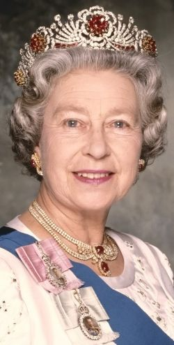 HM Queen Elizabeth II of Great Britain wearing the BURMESE RUBY TIARA, along with the magnificent ruby necklace, known as the State Rubies, left to the Crown by Queen Victoria.  The Queen received the rubies from the people of Burma as a Coronation gift. Queen Elizabeth II sent the rubies to Garrad's to create a new tiara in 1973.