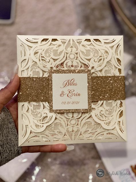 This gorgeous ivory laser cut wrap features a rose gold glittery belly band with tag and a rose gold backer. It is perfect for any wedding and breathtakingly beautiful! #wedding#weddinginvitations#stylishwedd #stylishweddinvitations #vellumweddinginvitations