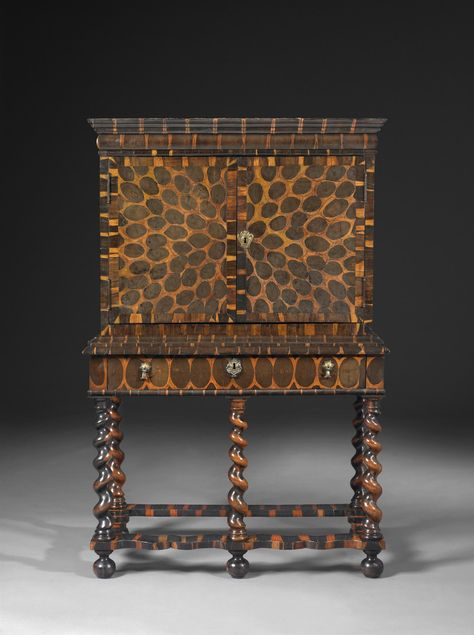 A Charles II very rare William and Mary oyster veneered cocus wood cabinet on stand.