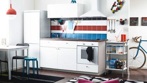 Modern white kitchen with HÄGGEBY fronts and dark laminate worktop