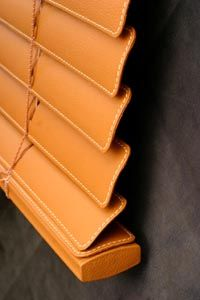 Blinds with leather