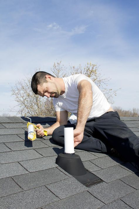 Roof Repair Roofer Repairing Leaks Around Vent Pipes On Home Roof
