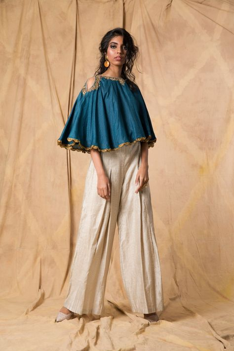 Teal muga tussar cape, hand-embroidered with zardozi with ivory striped palazzo pants.