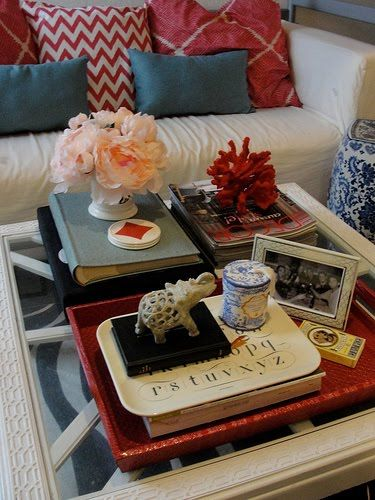 Grey, red, and turquoise for living room decor. Add some pops of yellow to brighten it up. Like the table