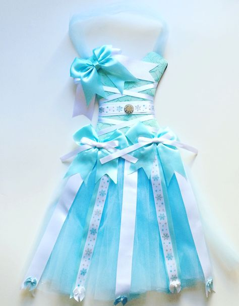 A great accent to any girl's room. A tutu dress made to keep your bows on. The bodice of this bow holder is in a gorgeous blue and white embellished with rhinestone accents. The waist is accented with
